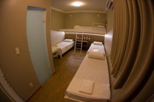Cama ou camas em um quarto em Hotel Esplanada