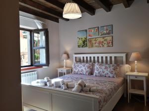 Cama o camas de una habitación en Apartamentos San Antonio