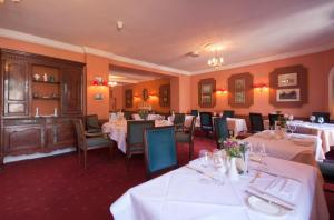 A restaurant or other place to eat at Corse Lawn House Hotel