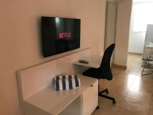 A television and/or entertainment center at Wave Beach Vacation Rentals