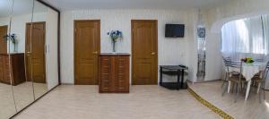 Телевизор и/или развлекательный центр в Апартаменты на Ленина 54