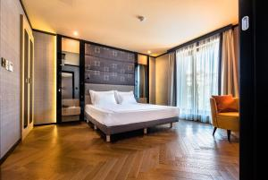 A bed or beds in a room at CITY Hotel Sofia