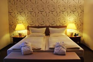 Кровать или кровати в номере Hotel Ratswaage
