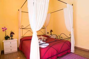 Letto o letti in una camera di B&B L'Albero Dei Limoni