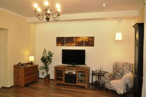 A television and/or entertainment center at Atmospheric Quiet Apartment