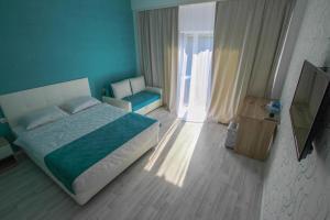 Кровать или кровати в номере El Patio