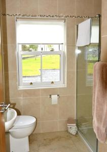 A bathroom at Rivers Bend Cottage