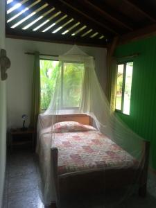 A bed or beds in a room at Hotel Suizo Loco Lodge & Resort