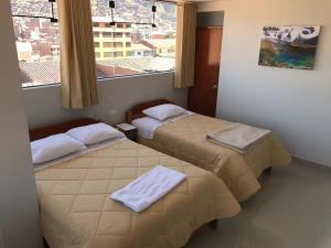 Cama o camas de una habitación en Edmoli Casa Hospedaje