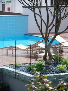 The swimming pool at or near Claremont Quarter Luxury Apartment