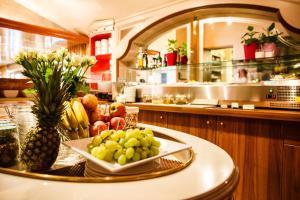 A kitchen or kitchenette at Hotel Salzburg