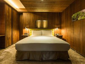 A bed or beds in a room at inhouse residence