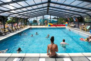 The swimming pool at or near Camping de l'Eve****