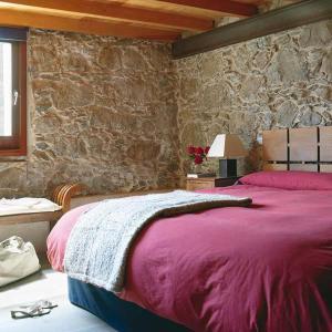 Een bed of bedden in een kamer bij Finca La Salud