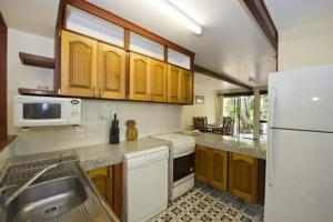 A kitchen or kitchenette at Magnetic Island Holiday House