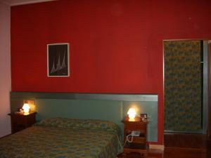 Letto o letti in una camera di Hotel Valganna - Tre Risotti