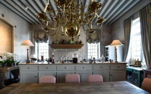 A kitchen or kitchenette at Château du Tertre