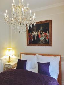 Postel nebo postele na pokoji v ubytování Imperium Residence