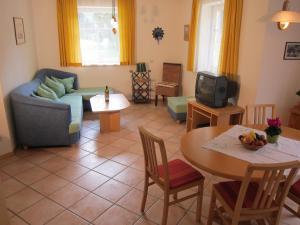 Ein Sitzbereich in der Unterkunft Appartement Millennium