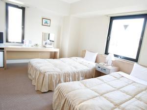 天童珍珠城市飯店房間的床