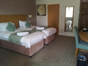 A bed or beds in a room at Deangate Motel