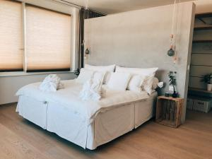 A bed or beds in a room at AVLiving City LOFT Basel