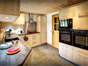 A kitchen or kitchenette at Fleur des Neiges Grand Bornand - OVO Network