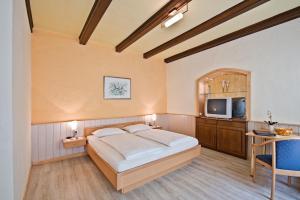 Ein Bett oder Betten in einem Zimmer der Unterkunft Pension Martha