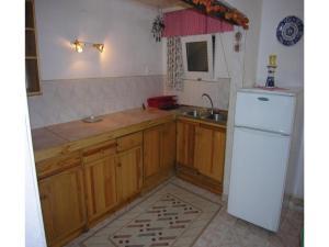 Kuchnia lub aneks kuchenny w obiekcie Holiday home Szczytno Piece