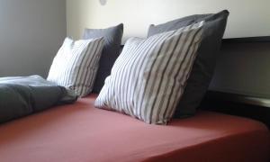 Een bed of bedden in een kamer bij Halte 10 Apartment