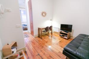 A seating area at Flinders Lane Superior Studio Apartment