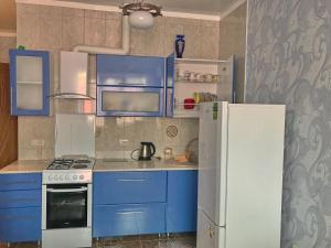 A kitchen or kitchenette at Apartment on Lenina 221/6