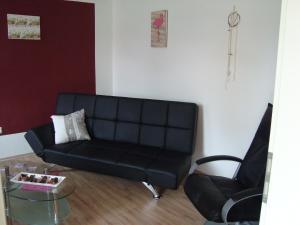 Ein Sitzbereich in der Unterkunft Zum Hafergarten