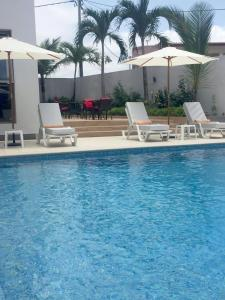 The swimming pool at or near Fly Hotel