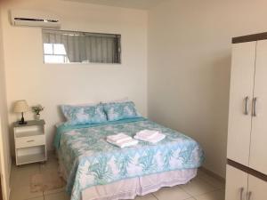 Cama ou camas em um quarto em Apto. Vista Mar