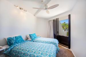 A bed or beds in a room at The Rocks Resort, Unit 1E
