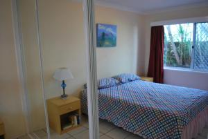 A bed or beds in a room at BRIGADINE TUGUN, UNIT 2