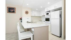 A kitchen or kitchenette at THE ROCKS RESORT, UNIT 11i