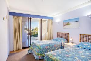 A bed or beds in a room at THE ROCKS RESORT, UNIT 9J