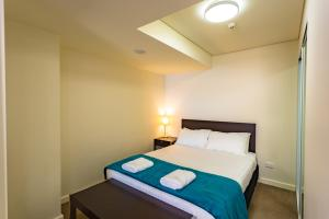 A bed or beds in a room at Hotel 111