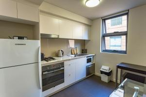 A kitchen or kitchenette at Hotel 111