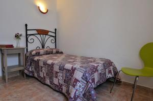 Cama o camas de una habitación en Hospedaje Facundo