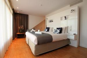 A bed or beds in a room at The Bank Hotel
