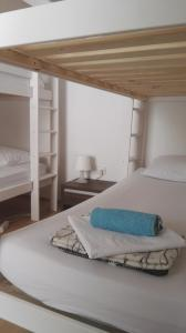 A bed or beds in a room at Hostel Piran
