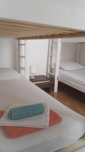 A bunk bed or bunk beds in a room at Hostel Piran