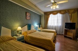Кровать или кровати в номере Hotel Internacional