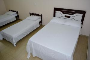 A bed or beds in a room at Hotel Consalter
