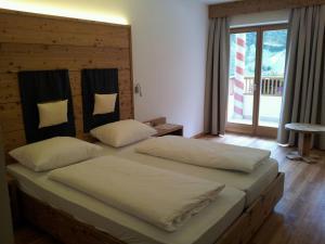 Ein Bett oder Betten in einem Zimmer der Unterkunft Hotel Argentum