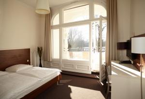 Ein Bett oder Betten in einem Zimmer der Unterkunft Hotel Excellent