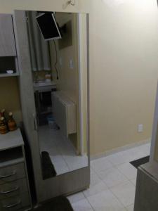 Um banheiro em Suíte Privativa Aconchegante